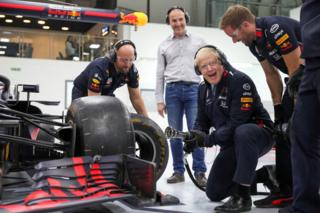 The White House Prime Minister Boris Johnson changes a wheel on a Formula One car during a visit at Red Bull Racing in Milton Keynes