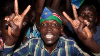 South Sudanese civilians celebrate the signing of a cease fire and power sharing agreement between President Salva Kiir and rebel leader Riek Machar, in Khartoum; along the streets of Juba, South Sudan August 5, 2018