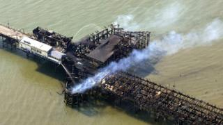 Aerial photo showing smouldering buildings on Southend Pier