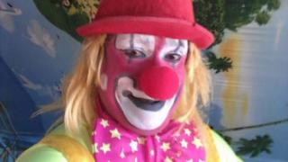 Clown poses for a selfie