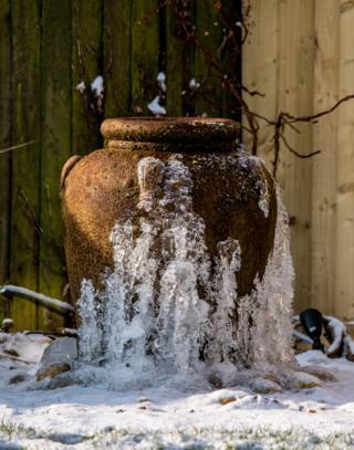 A frozen garden water feature
