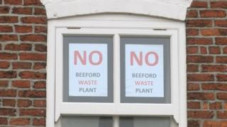 Posters objecting to plans to build an anaerobic digester near Beeford