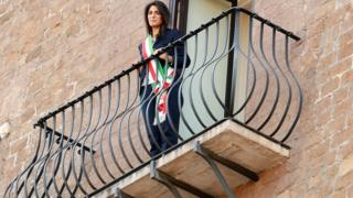 Rome's mayor Virginia Raggi stands on the balcony of the Rome's city hall after her victory in June