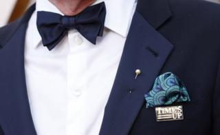 Richard Jenkins wearing a Time's Up pin