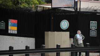 A woman waits at the US embassy in Ankara in October