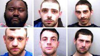 Police mug shots of six men