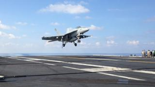 An FA-18 jet fighter takes off on the USS John C. Stennis, aircraft carrier in the South China Sea on Friday, April 15, 2016