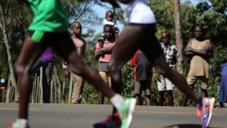 Athletes run a half marathon near Eldoret in western Kenya, March 20, 2016