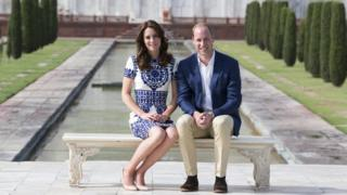 The Duke and Duchess of Cambridge sitting in front of the Taj Mahal