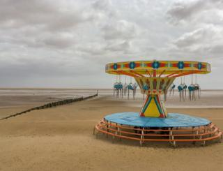 A merry-go-round on a beach