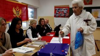 Woman casts her ballot