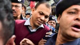 Bangladeshi Commander in the Rapid Action Battalion (RAB) Tarek Sayeed (centre) is escorted by police at Narayanganj court in Narayanganj on January 16, 2017.