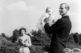 Prince Charles being lifted up by his father The Duke of Edinburgh