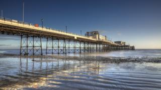 Worthing Pier at low tide during sunset