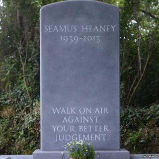 The inscription on the headstone is a line from Seamus Heaney's poem The Gravel Walks