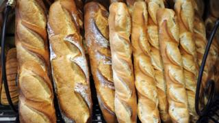 Baguettes and breads are on display in a bakery of Quimper on May 11, 2015, western of France.