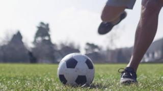 man about to kick football