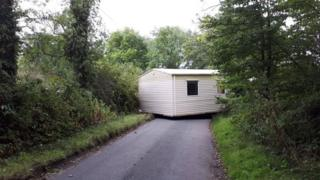 Mobile home blocking road