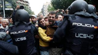 Spanish police and protesters in Catalonia