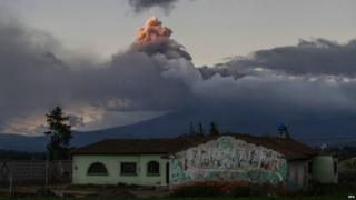 An ash cloud can be seen rising from the Cotopaxi volcano in the photo taken from Saquisili village on 15 August 2015