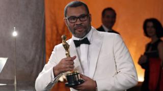 Jordan Peele with his Oscar