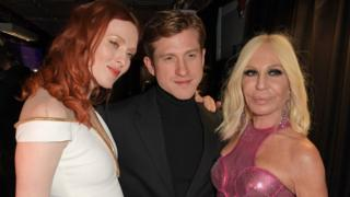 (Left to right) Karen Elson, Daniel Lee and Donatella Versace