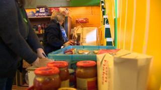 Volunteers stack food at a food bank in Ebbw Vale