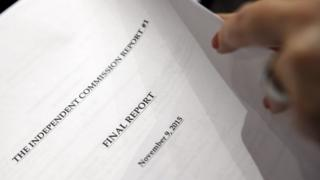 A reporter holds the report of the Commission's Report surrounding allegations of doping prior a press conference, in Geneva, Switzerland (09 November 2015)