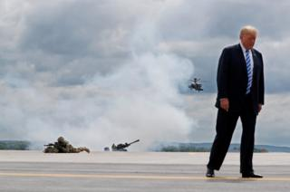 US President Donald Trump observes a demonstration with U.S. Army 10th Mountain Division troops, an attack helicopter and artillery as he visits Fort Drum, New York, U.S., 13 August 2018.