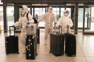 in_pictures Passengers determined to avoid the coronavirus before leaving the UK arrive at Gatwick Airport departure area.