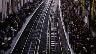 Commuters wait for a Thameslink train