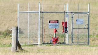 A well head is fenced off in a paddock in the Hunter Valley town of Broke, north west of Sydney