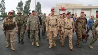 Turkish Army Commander Ismail Metin Temel (3rd left) walks with Iraq Chief of Staff General Othman al-Ghanmi (C) during a meeting with Turkish and Iraqi soldiers at the Habur border gate, Turkey (31 October 2017)