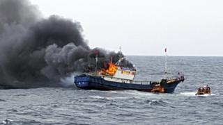 A Chinese fishing boat catches fire during an inspection by the South Korean coast guard in the water off Hong Island, South Korea, September 29, 2016