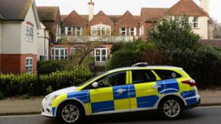 Police car outside the home