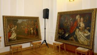"""Paintings are seen on display during a news conference at the Ukraine""""s Security Service headquarters in Kiev, Ukraine, April 14, 2016."""