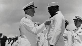 Admiral Chester W Nimitz, left, pins the Navy Cross on Doris Miller