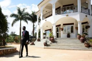 Ugandan pop star turned opposition MP, Robert Kyagulanyi better known as Bobi Wine, walks with a cane to attend his media conference at his home in Kampala on September 24, 2018.