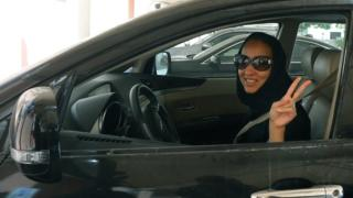 File photo: Saudi activist Manal Al Sharif poses in a car in Dubai, in solidarity with a planned protest in Saudi Arabia, 22 October 2013