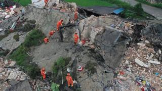 Rescue workers on a collapsed house after earthquakes hit Changning county in Yibin, Sichuan province, China June 18, 2019