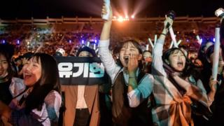 Fans cheer for their a professional K-pop band in Changwon, South Korea