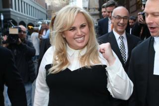 Rebel Wilson celebrates as she leaves court in Melbourne, Australia, in June