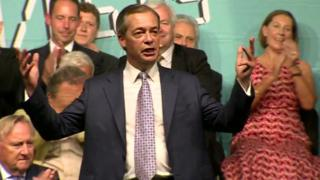Nigel Farage, surrounded by Brexit Party election candidates