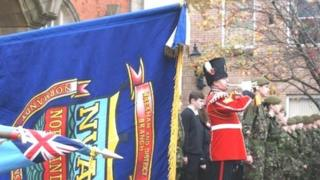Flags and bugler in Wrexham during a remembrance service in 2013