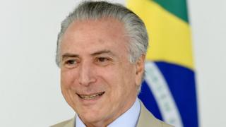 Brazilian acting President Michel Temer gestures during the presentation of new ministers at Planalto Palace in Brasilia on May 18, 2016.