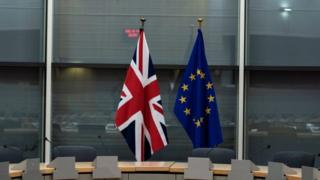 A British and an EU flag at the EU Commission HQ in Brussels