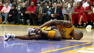 Kobe Bryant lies injured at a game.