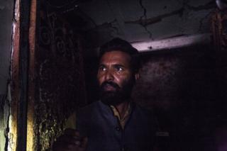 Mohammad Munazir in his burnt home