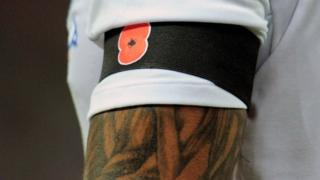 England's Glen Johnson displays a poppy on an armband during the international friendly match between England and Spain in 2011