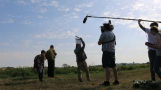 Filming for Nene showing a film crew with cameras